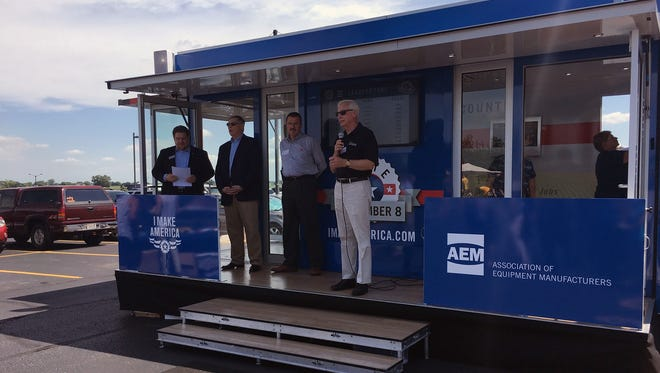 Jim Wessing addresses the community and Kondex associates. Additional speeches were given by, from left: Congressional Field Rep. Alan Ott, Fond du Lac County Economic Development Corp. President Steve Jenkins, and AEM President Dennis Slater.