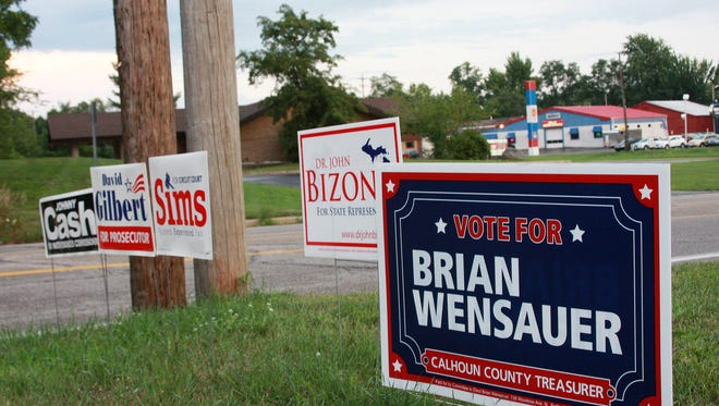 Signs on Main Street in Emmett Township ahead of the primary election Tuesday.