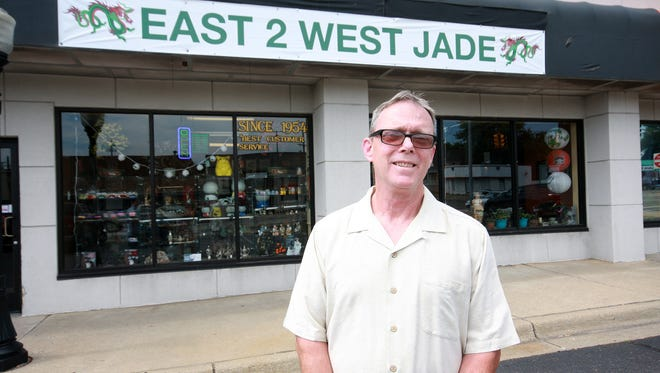 Chalon Lindsley, owner of East 2 West Jade, stands outside his store in the Old Lakeview neighborhood in Battle Creek.