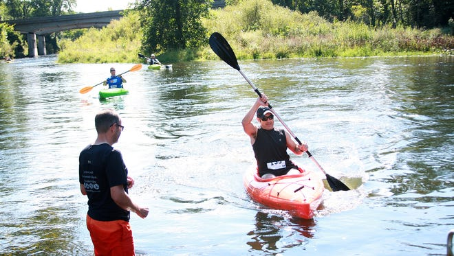 Fernando Rosa finishes kayaking at Historic Bridge Park during The Chief's Challenge Triathlon
