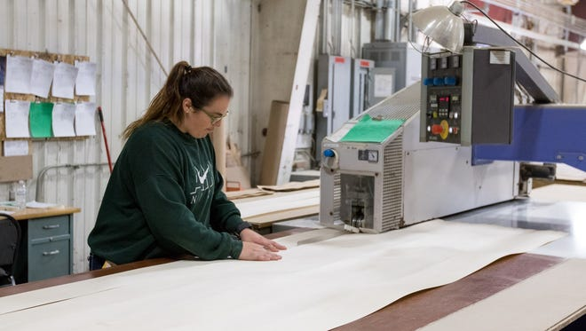An employee works at Spencer-based Protect Door, LLC, Oct. 18, 2016.