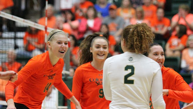 CSU volleyball players, from left, Alexandra Poletto, Paulina Hougaard-Jensen, Cassidy Denny and Katie Oleksak celebrate winning a piont during the Rams' sweep of Utah State on Saturday at Moby Arena.