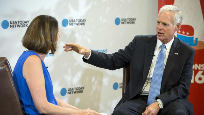 Jul 19, 2016; Cleveland, OH, USA; USA TODAY reporter Donovan Slack (left) interviews Republican senator Ron Johnson, of Wisconsin during the 2016 Republican National Convention at Quicken Loans Arena. Mandatory Credit: Kelly Jordan-USA TODAY NETWORK