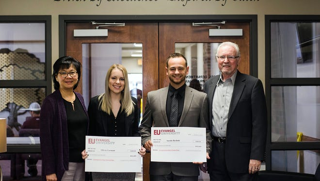 Evangel University senior business students Olivia Gorman of Springfield and Austin Beshuk of Jefferson City each received $500 entrepreneurship scholarships, funded by alumni Marc and J. Adam Dobberstein. Presenting the funds were business professors Eveline Lewis (left) and Duane Praschan, department chair.