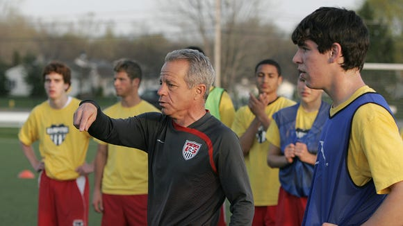 Brighton native Dave Sarachan instructs Empire United players in a drill at Roberts Wesleyan College in 2008.