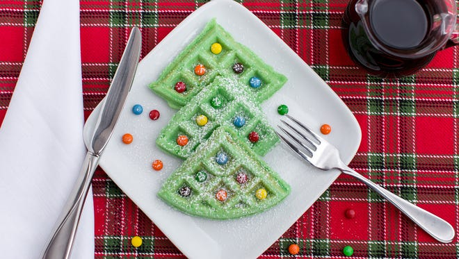 Food coloring and candy is used to transform a traditional waffle recipe into a festive Christmas breakfast.