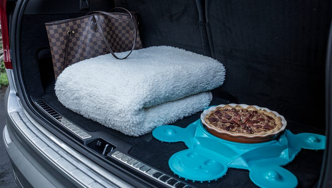 The Pie Turtle sits in the back of a car to keep pies or cakes from sliding around during transportation.