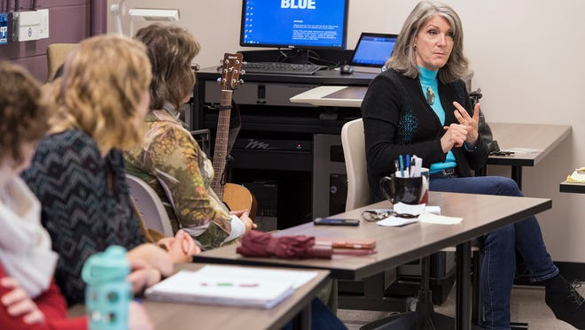 "Grammy-winning country music artist Kathy Mattea makes a point during her guest lecture to MTSU professor Kris McCusker's ""American Music in the Modern Age"" class inside Peck Hall in late November."
