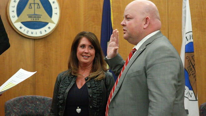 Commissioner Derek King is sworn in as the county board's chairman after being unanimously selected by his peers during the organizational meeting Thursday.