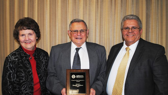 Donald Andrews, AgSource's 2017 Friend of the Cooperative, is congratulated by his wife, Shirley, (L) and AgSource Director of Member and Field Services, Tom DeMuth (R).