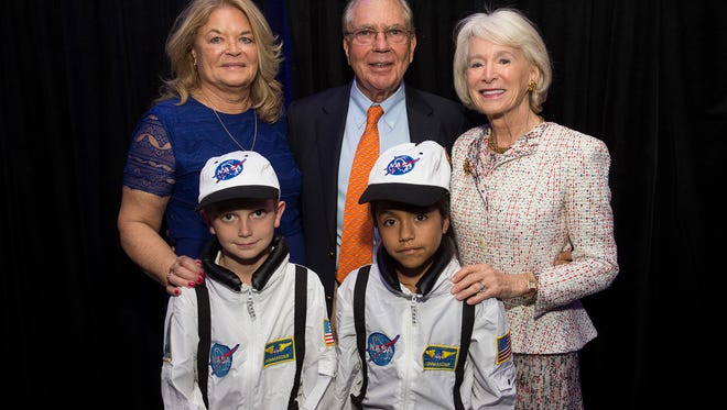 Joanne Towner, CEO of Boys & Girls Clubs of Martin County; William F. Whitman, the organization's board president; and Barbara Whitman with Jr. Astronauts