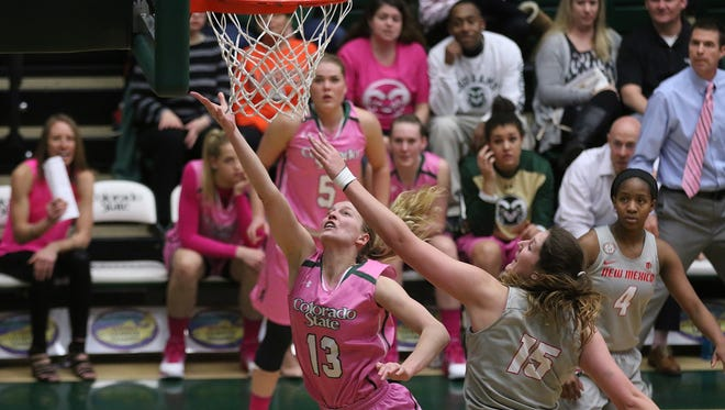 Colorado State University senior Ellen Nystrom drives to the hoop during the final minutes of the game against The University of New Mexico. The Rams defeated the Lobos 58-55 in Fort Collins.