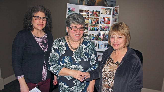 """(From left) Rosalie Forcinito, president, Zonta Club of Cumberland County; Dorothy Marketto, international director for Omie's Home for Children and Beyond; and Josie Neill, treasurer, Zonta Club of Cumberland County, mark the """"adoption"""" by Zonta Club of Omie's Home."""