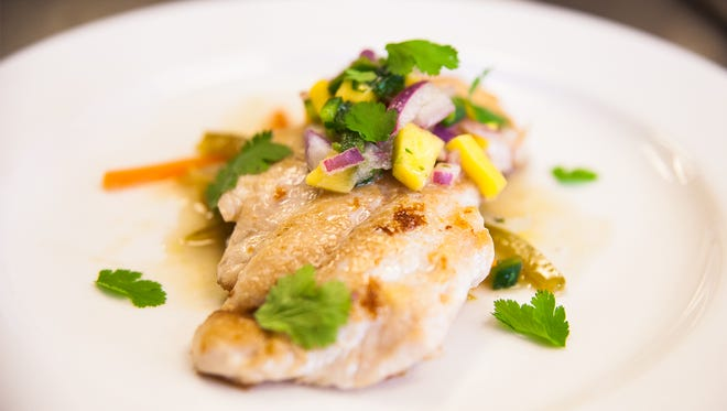Escovich is topped with a fresh mango salsa.Think spring.