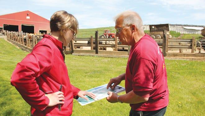 Michelle Komiskey, NRCS District Conservationist, and Jack Herricks, Herricks Dairy Farm, discuss conservation planning.