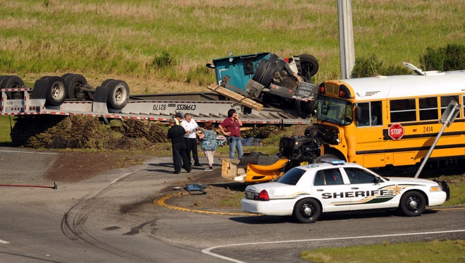 Images from an accident between a semi-trailer and a St. Lucie County School District school bus in March 2012.