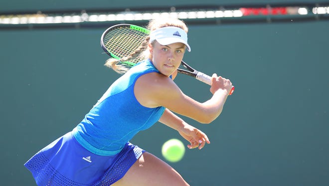 Ellie Douglas returns the ball at the Easter Bowl Friday at Indian Wells Tennis Garden.