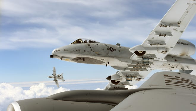 Two A-10 Thunderbolt II aircraft of the 107th Fighter Squadron from Selfridge Michigan, roll away from a KC-135 Stratotanker of the 171st Air Refueling Squadron also from Selfridge Michigan, after an air refueling while flying over Latvia, during the NATO exercise Saber Strike on June 21, 2016. The Michigan National Guard is part of a Department of Defense sponsored State Partnership Program between Michigan and the Latvian government, which began in 1993.