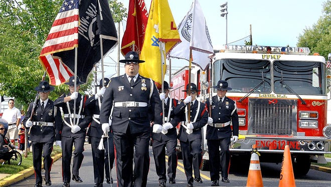 The Lodi Fire Department Honor Guard at a past year's Memorial Day services at the Fire Department Monument.