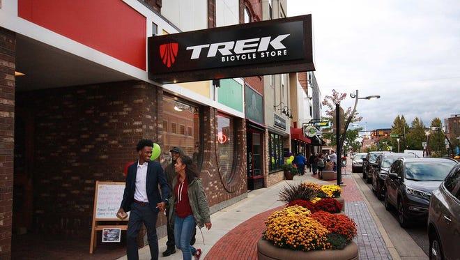 People walk around near Trek Bicycle Store in downtown Battle Creek in 2016.
