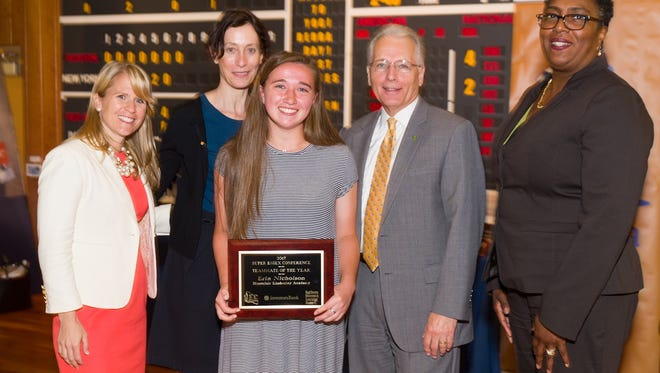 Erin Nicholson of Montclair Kimberley Academy (center)  received the Investors Bank Best Teammate Award on May 24 at an event The Yogi Berra Museum & Learning Center. Left to right: Beth Gottung, guest speaker at the event and former MSU field hockey coach; Eve Schaenen, Yogi Berra Museum & Learning Center Executive Director; Robert Zajac, Investors Bank V.P. & Regional Manager, and Alicia Robinson, Investors Bank Montclair Manager