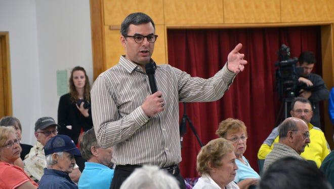 U.S. Rep. Justin Amash, R-Cascade Township, took questions from constituents for two hours during his town hall Thursday in Battle Creek.