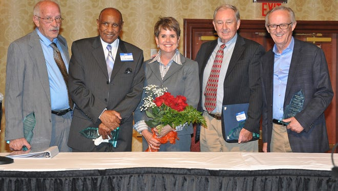 WSMV-TV news anchor Demetria Kalodimos, center, is shown with the four Class of 2017 inductees into the Tennessee Journalism Hall of Fame following the Aug. 15 induction ceremony at Embassy Suites in Murfreesboro. Shown from left to right are Don Whitehead, the first African-American radio news broadcaster for WLAC Radio in Nashville, retired; Tom Humphrey, retired Nashville bureau chief for the Knoxville News Sentinel; Kalodimos, who emceed the ceremony; Larry Woody, retired sports journalist, The Tennessean; and Leon Alligood, former Nashville Banner and Tennessean writer and current associate journalism professor at MTSU. (Photo courtesy of Hooper Penuel)
