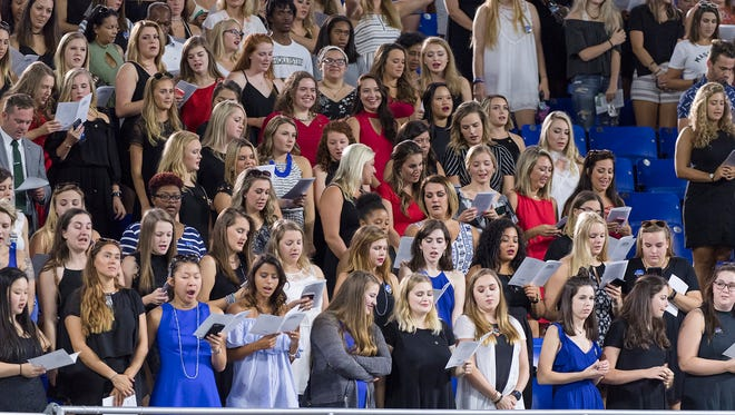 Middle Tennessee State University students recite the True Blue Pledge during University Convocation held Saturday, Aug. 26, in Murphy Center.