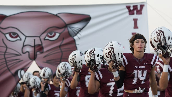 The Calallen Wildcats make their way to the football field during their game against Mercedes. Friday. Sept. 1, 2017 in Calallen.