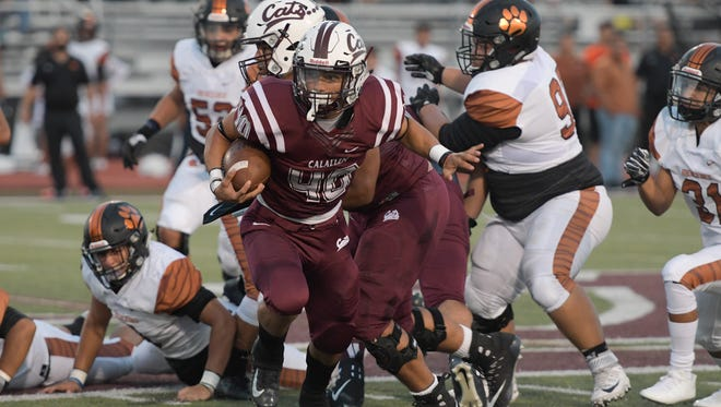 Calallen Wildcats' Alec Brown (40) rushes through the Mercedes Tigers defense.