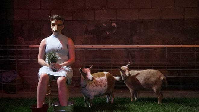 """Jimmi Weyneth performs with the Oak Hollow goats in Wild Space Dance's """"Artifacts."""""""