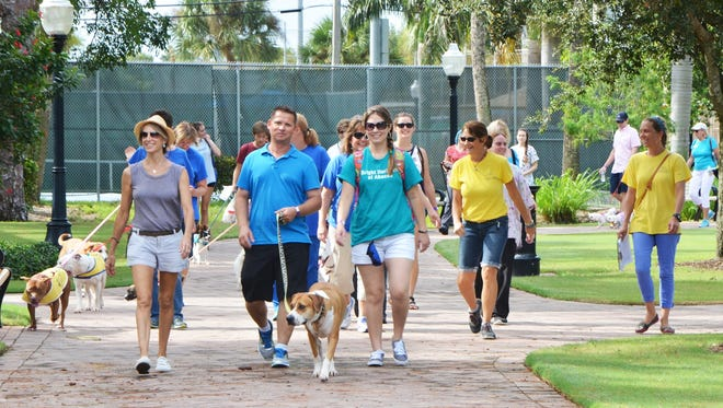 A walk around Memorial Park is part of the fun during the Mutt March.
