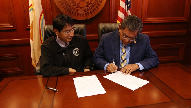 Navajo Nation President Russell Begaye, right, and Vice President Jonathan Nez sign a proclamation on Oct. 2 recognizing Indigenous Peoples Day on tribal land.