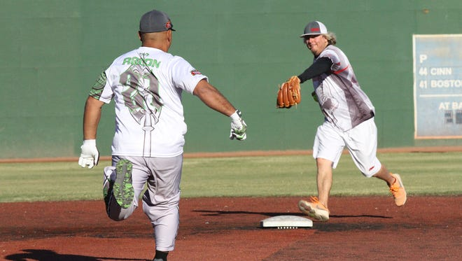 Sindalu Guahan's Jesse Aguon is forced out at second base against Washington Vortex during the 2017 2017 LVSSA/SSUSA World Masters Softball Championship Men's AAA Division Oct. 7, 2017, in Las Vegas.