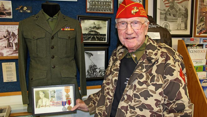 World War II veteran Walter Kocielski, in front of his uniform and other artifacts that tell the story of his experiences on Iwo Jima, attended Millville Army Air Field Museum's Veterans Appreciation Day 2016 at Millville Airport. Kocielski is a docent at the museum.