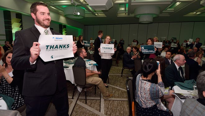 Members of the nursing and mental health communities hold up signs thanking McLaren Greater Lansing and MSU for their partnership to address the area's mental health needs with the $1.5 million endowment.
