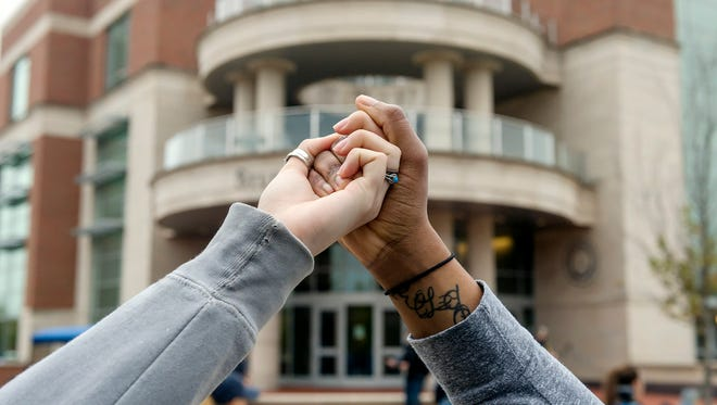 """MTSU's Student Government Association created the campuswide Hands Across MTSU  to publicly embrace all members of the Blue Raider community.  Nov. 6, students, faculty, staff, alumni and supporters across campus joined hands to form a human chain """"to promote unity and solidarity,"""""""