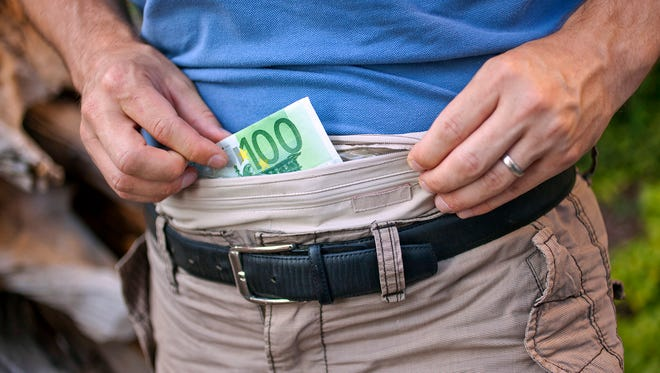 Rick Steves recommends wearing a moneybelt tucked underneath your clothes for security (he wasn't when he was pickpocketed.