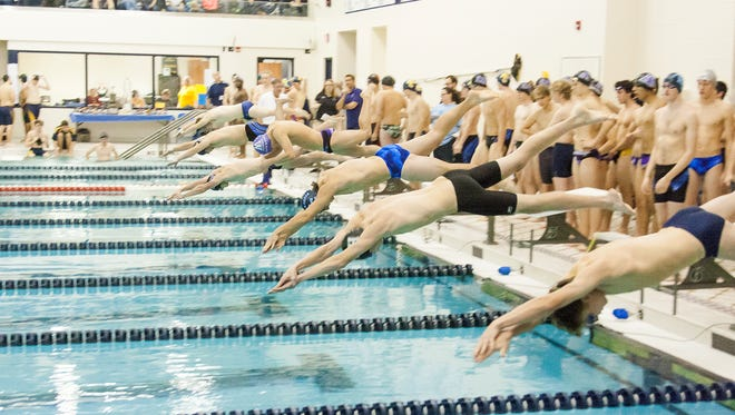 Swimmers take off for the 500 Yard Up-Down Relay during the Cereal Bowl Relay Saturday afternoon