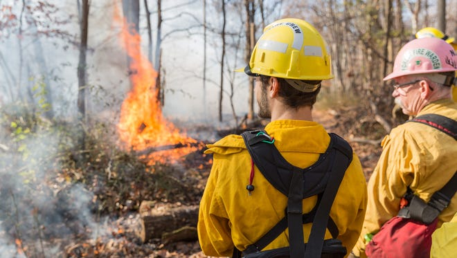 """Representatives of the Somerset County Park Rangers and the New Jersey Department of Environmental Protection perform a """"controlled burn"""" at Washington Valley Park in Bridgewater."""