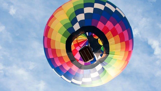 Pilot Tom Roush flies Git-R-Done during the 2017 Field of Flight Air Show & Balloon Festival.