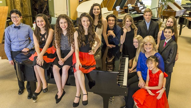 "From left, sitting or standing, are Gabriel Sun, Demi Master, Skye Alyssa Friedman, (Jupiter) Jade Master, Isabella Caggiani, Nicholas Caggiani, Emily Rynasko, (Jupiter) Brian Copeland (Jupiter) Emily Shecter and Jacques Coury. Seated are Karen Copeland (Jupiter) Kathi Kretzer-Sayler and Josetta Wang. These young performers are part of the Kretzer Piano Music Foundation's ""Kretzer Kids"" program. They perform more than 60 concerts a year in nursing homes, assisted living facilities, at community events and children's hospitals. They sing, play piano, violin and trumpet to the delight of their audiences."