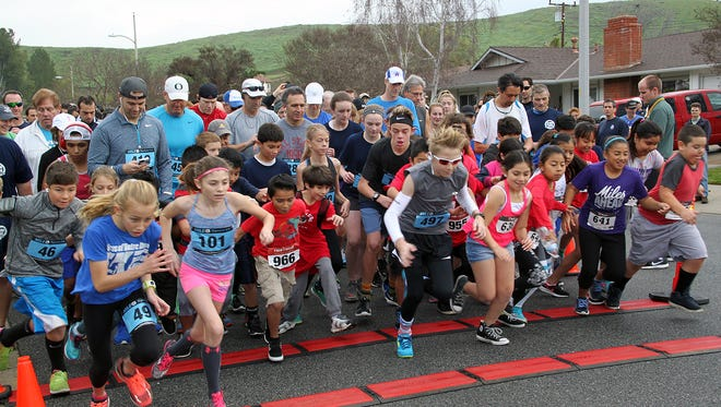 Runners take off at the start of the 2017 Nun Run. This year's run is Feb. 3.