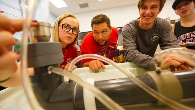 Midwestern State University students Bailey Kaufman, Christian Gregory, Ryan Fidlar, and Jocelyn Brown take measurements in their fluid mechanics lab in the McCoy School of Engineering. The naming of the McCoy College of Science, Mathematics and Engineering now links every dimension of scientific and mathematical teaching, learning and research at MSU Texas and honors the McCoys' legacy of support to the engineering program, also named in the family's honor.