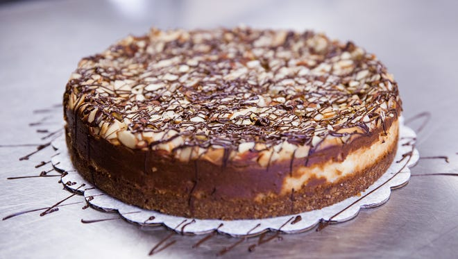 This Coconut-Almond Cheesecake is a bit of an homage to the author's mom, incorporating the flavors of one of her favorite candy bars.
