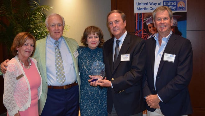 Enjoying the reception are, from left, Debi Owens of Wilmington Trust, Bob Croce, Linda and Dennis Longstreet, and Richard Dakers
