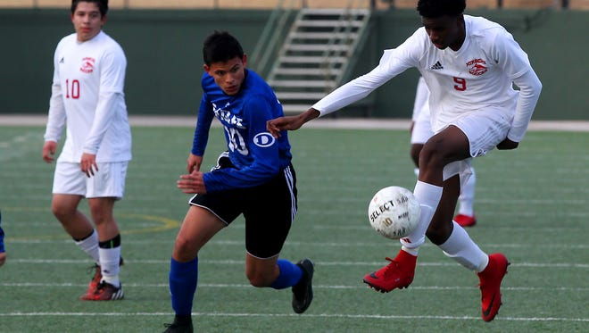 Hirschi's Shaughnessy Emanuel controls the ball during the first half of Tuesday's meeting against Decatur