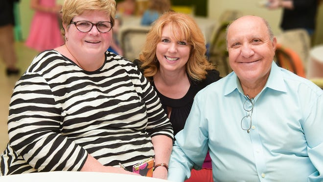 Sharon Saraniti, left, Judith Cruz, president and CEO of Treasure Coast Food Bank, and Sal Saraniti.