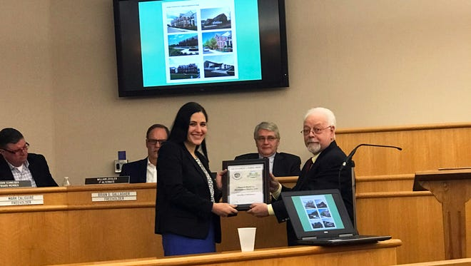 Montgomery Deputy Mayor Christine Madrid receiving the Excellence in Planning award from Somerset County Planning Board Chairman Bernard Navatto Jr.