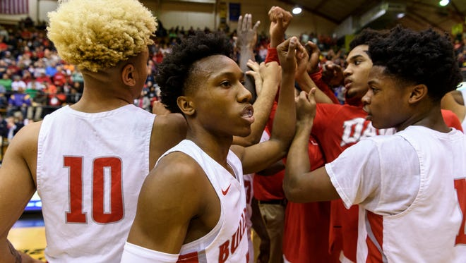 The Bosse Bulldogs huddle before taking on the Danville Warriors in the IHSAA Class 3A semi state match up at the Hatchet House in Washington, Ind., Saturday, March 17, 2018.